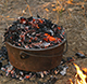 camp oven cooking with hot coals